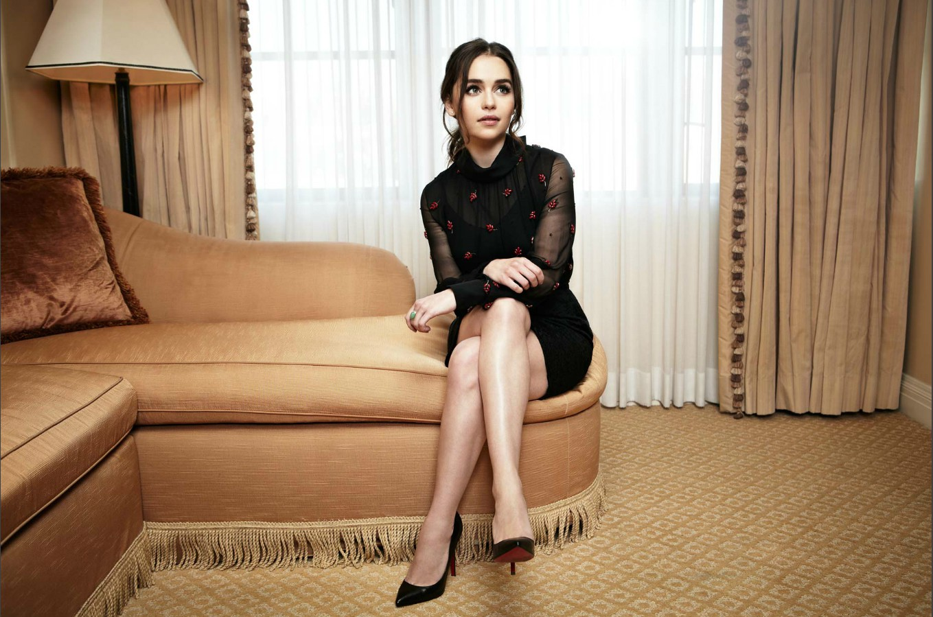 emilia clarke beautiful pose and stylish sitting in sofa still mobile hd background download free images