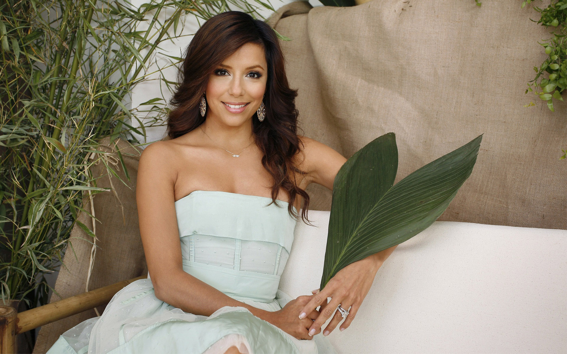 fantastic eva longoria cute smile face with tree leaf in hands and background tree hd desktop free mobile images