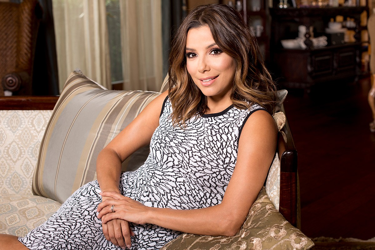 lovely eva longoria cute smile and sitting pose in sofa background mobile free hd images