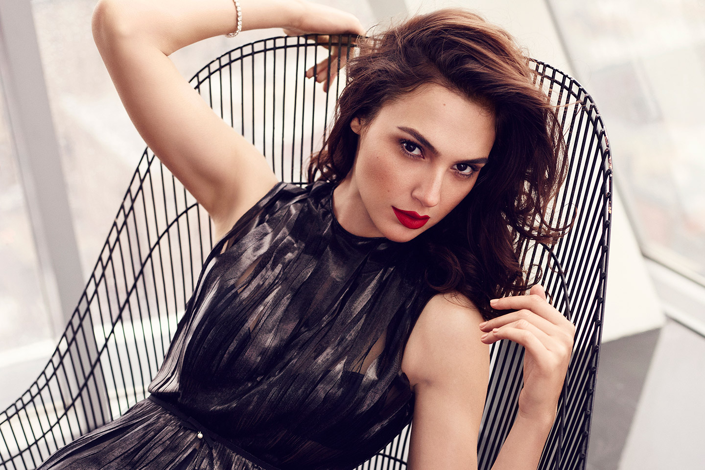 free gal gadot wonderful pose in black chair mobile desktop background hd images