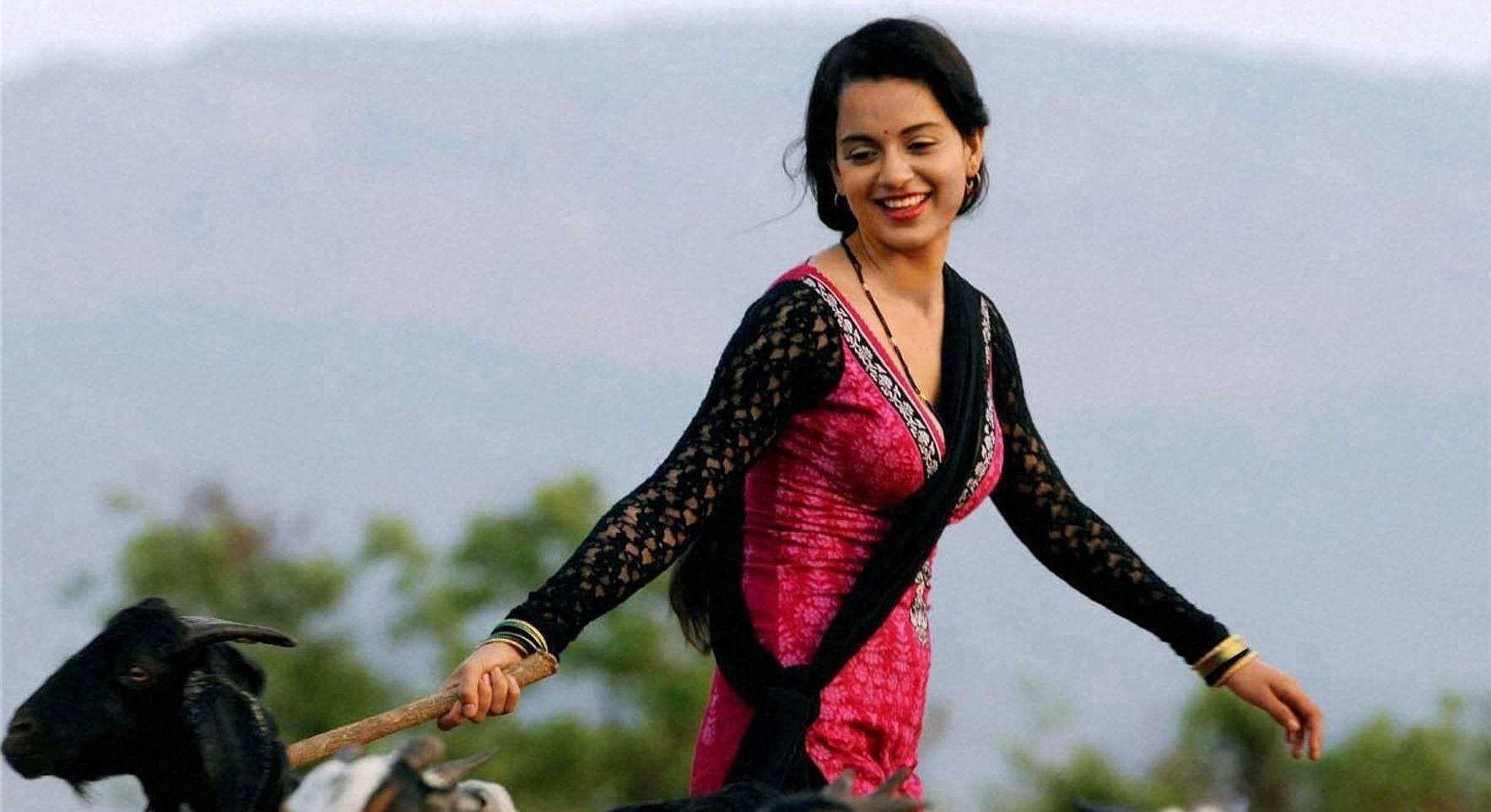 lovely kangana ranaut smiling with goat deskop background mobile hd images free