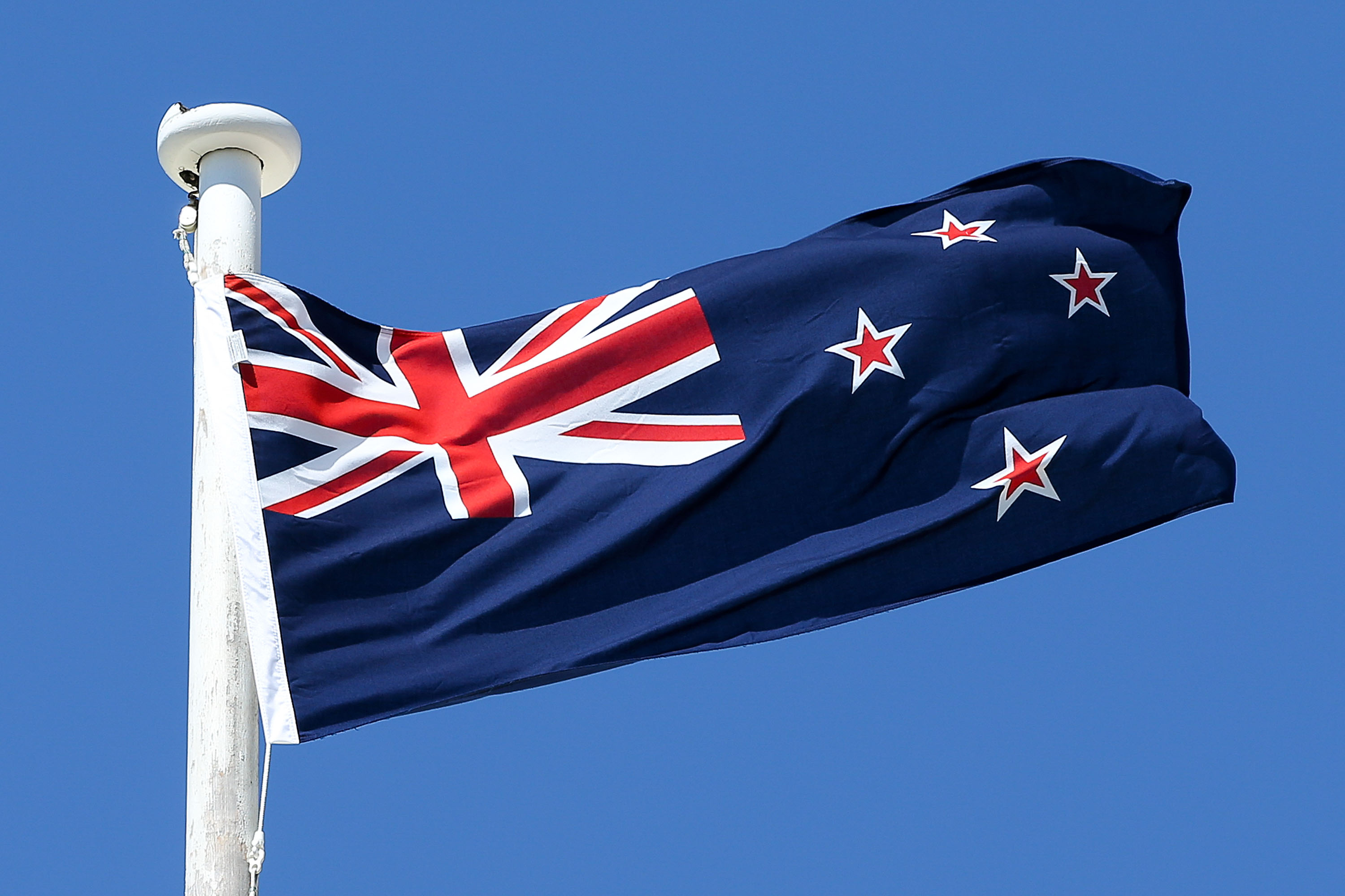 Newzealand National Flag Waving In Wind Hd Wallpaper Download