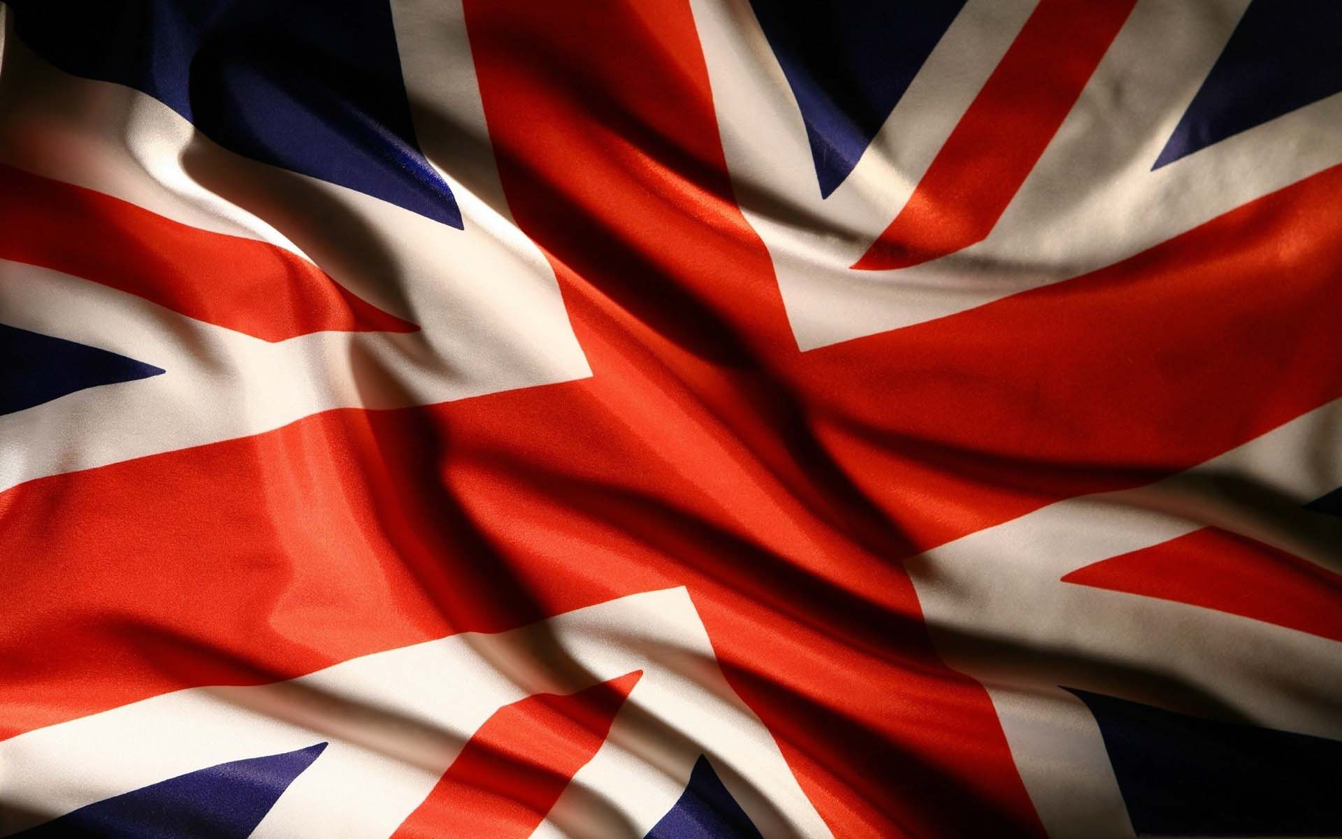waving uk flag on wind wallpaper download